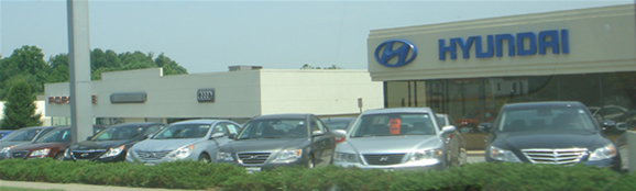 A car dealership carrying auto brands such as Audi, Hyundai, and others.